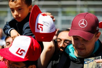 Signed Lance Stroll, Racing Point, hats are worn by fans