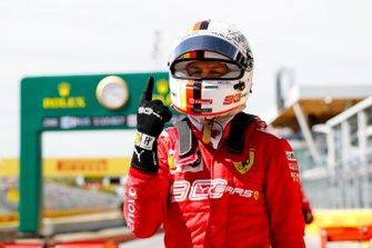 Pole man Sebastian Vettel, Ferrari, celebrates
