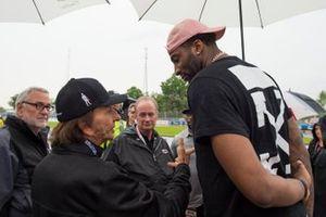 Emerson Fittipaldi talks to Grand Prix Grand Marsh Andre Drummond, of the Detroit Pistons