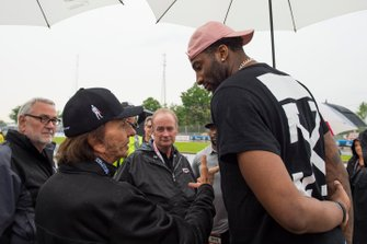 Emerson Fittipaldi talks to Grand Prix Grand Marsh Andre Drummond, of the Detroit Pistons