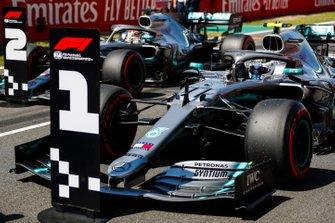 Pole Sitter Valtteri Bottas, Mercedes AMG W10 and Lewis Hamilton, Mercedes AMG F1 W10 in Parc Ferme