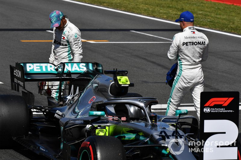 Lewis Hamilton, Mercedes AMG F1, and pole man Valtteri Bottas, Mercedes AMG F1, on the grid after Qualifying