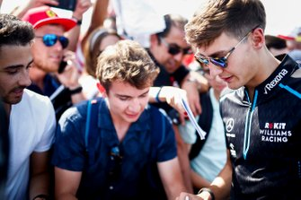 George Russell, Williams Racing signs a autograph for a fan