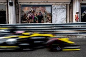 Daniel Ricciardo, Renault R.S.19, passes a Gucci shop