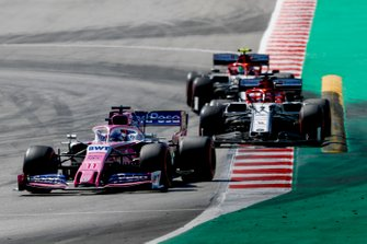 Sergio Perez, Racing Point RP19, leads Kimi Raikkonen, Alfa Romeo Racing C38, and Antonio Giovinazzi, Alfa Romeo Racing C38