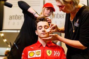 Charles Leclerc, Ferrari, has his make up done
