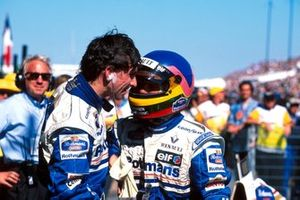 Jacques Villeneuve, Williams congratulates race winner Damon Hill, Williams and Charlie Whiting, FIA official delegate