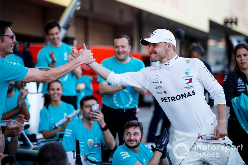 Valtteri Bottas, Mercedes AMG F1, 1st position, and the Mercedes team celebrate after securing a win in the race and in the 2019 Constructors Championship