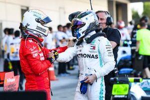 Sebastian Vettel, Ferrari, 2nd position, congratulates Valtteri Bottas, Mercedes AMG F1, 1st position, in Parc Ferme