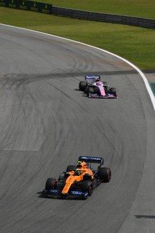 Lando Norris, McLaren MCL34, leads Lance Stroll, Racing Point RP19