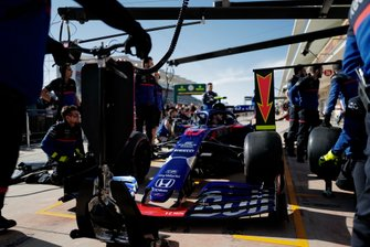 The Toro Rosso team practise a pit stop