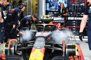 Mechanics at work on the car of Alex Albon, Red Bull RB15