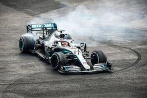 Race winner Lewis Hamilton, Mercedes AMG F1 W10 performs a donut