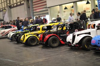 Some of the cars racing in the Live Action Arena on display