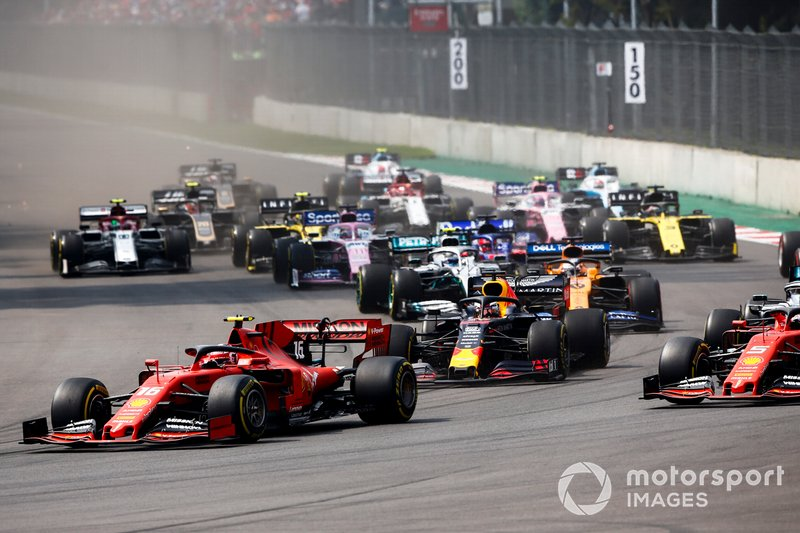 Charles Leclerc, Ferrari SF90, leads Sebastian Vettel, Ferrari SF90, Lewis Hamilton, Mercedes AMG F1 W10, Max Verstappen, Red Bull Racing RB15, Carlos Sainz Jr., McLaren MCL34, and the rest of the field at the start