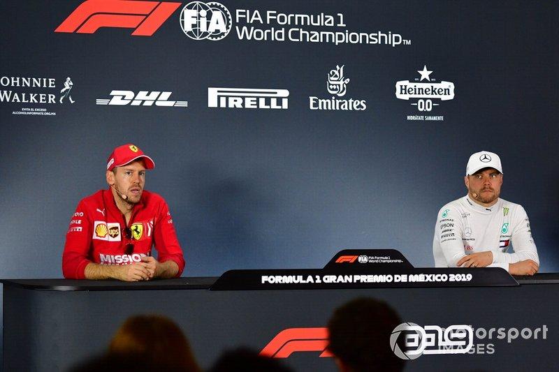 Sebastian Vettel, Ferrari, 2nd position, and Valtteri Bottas, Mercedes AMG F1, 3rd position, in the Press Conference