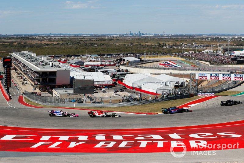 Romain Grosjean, Haas F1 Team VF-19, leads Daniil Kvyat, Toro Rosso STR14, Antonio Giovinazzi, Alfa Romeo Racing C38, and Lance Stroll, Racing Point RP19, through the first corner