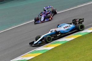 Daniil Kvyat, Toro Rosso STR14, rejoins after a spin as George Russell, Williams Racing FW42, passes