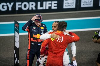 Charles Leclerc, Ferrari, 3rd position, congratulates Lewis Hamilton, Mercedes AMG F1, 1st position, after the race