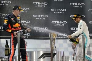 Max Verstappen, Red Bull Racing, 2nd position, and Lewis Hamilton, Mercedes AMG F1, 1st position, celebrate on the podium
