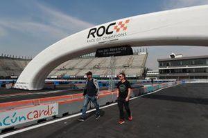 Fredrik Johnsson and Tom Kristensen walk the track