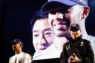 Lewis Hamilton, Mercedes AMG F1, and Valtteri Bottas, Mercedes AMG F1, on stage