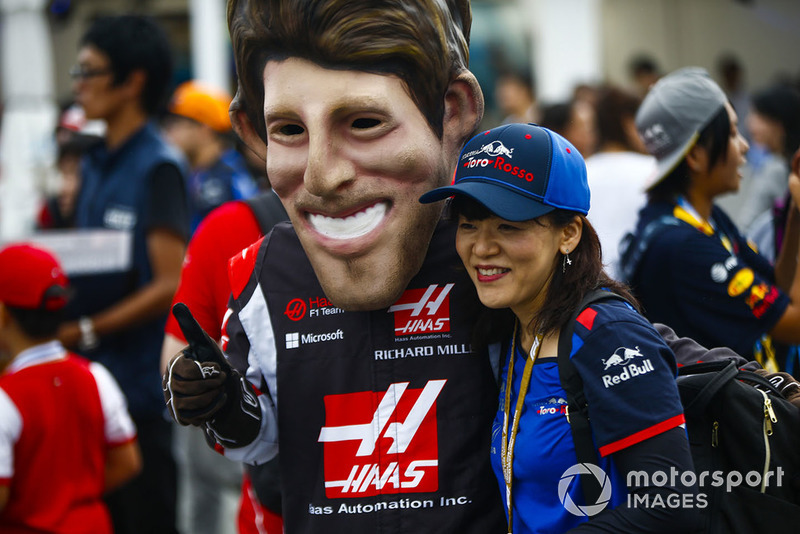 A fan gets a photo with a caricature of Romain Grosjean, Haas F1 Team