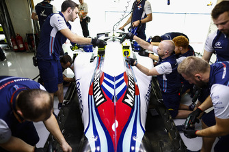 Team members work on the car of Sergey Sirotkin, Williams FW41, in the garage
