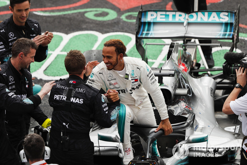 Lewis Hamilton, Mercedes AMG F1, celebrates becoming Champion for the 5th time with his team