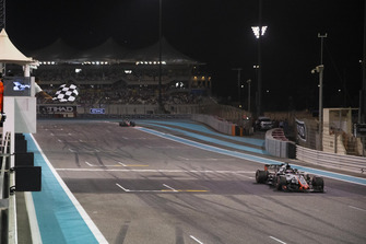 Romain Grosjean, Haas F1 Team VF-18 takes the chequered flag