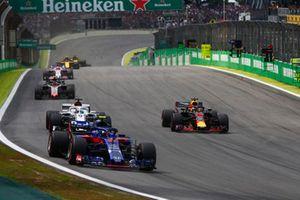 Pierre Gasly, Toro Rosso STR13 Honda, leads Daniel Ricciardo, Red Bull Racing RB14 Tag Heuer, and Marcus Ericsson, Sauber C37 Ferrari.