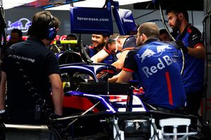 Mechanics work on the car of Pierre Gasly, Scuderia Toro Rosso STR13 in the garage