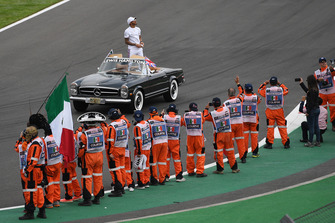 Lewis Hamilton, Mercedes AMG F1 and marshals on the drivers parade