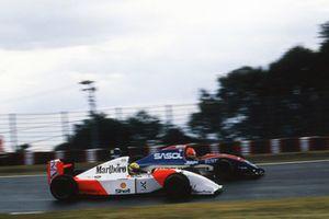 Ayrton Senna, McLaren Ford MP4/8 passes Eddie Irvine, Jordan Hart J193