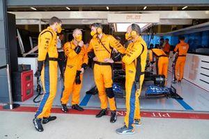McLaren mechanics outside the garage