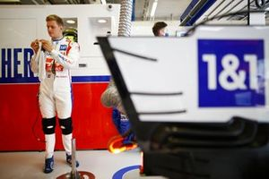 Mick Schumacher, Haas F1, prepares to put on his balaclava