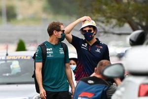 Sebastian Vettel, Aston Martin and Sergio Perez, Red Bull Racing arrives