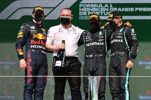 Max Verstappen, Red Bull Racing, 2nd position, the Mercedes trophy delegate, Lewis Hamilton, Mercedes, 1st position, and Valtteri Bottas, Mercedes, 3rd position, on the podium