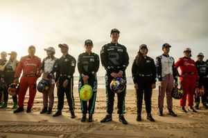Molly Taylor, Rosberg X Racing, and Johan Kristoffersson, Rosberg X Racing, pose for a photo on the beach with the other drivers