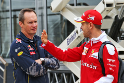 (L to R): Paul Monaghan, Red Bull Racing Chief Engineer with Sebastian Vettel, Ferrari