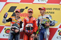 Podium: Race winner Casey Stoner, Ducati; second place Andrea Dovizioso; Repsol Honda; third place V