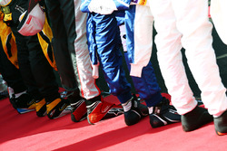 Racing boots as the grid observes the national anthem