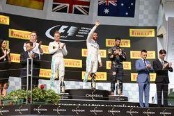 The podium: Nico Rosberg, Mercedes AMG F1, second; Lewis Hamilton, Mercedes AMG F1, race winner; Dan