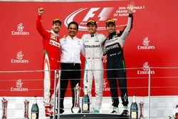 The podium (L to R): Sebastian Vettel, Ferrari, second; Nico Rosberg, Mercedes AMG F1, race winner; Sergio Perez, Sahara Force India F1, third
