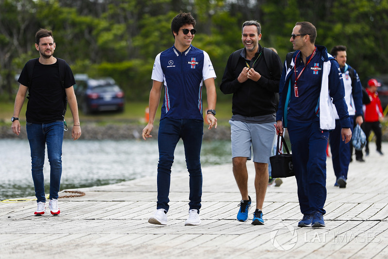 Lance Stroll, Williams Racing, arrives at the circuit with colleagues