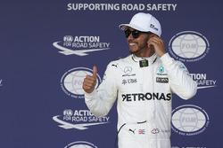 Polesitter Lewis Hamilton, Mercedes AMG F1, celebrates