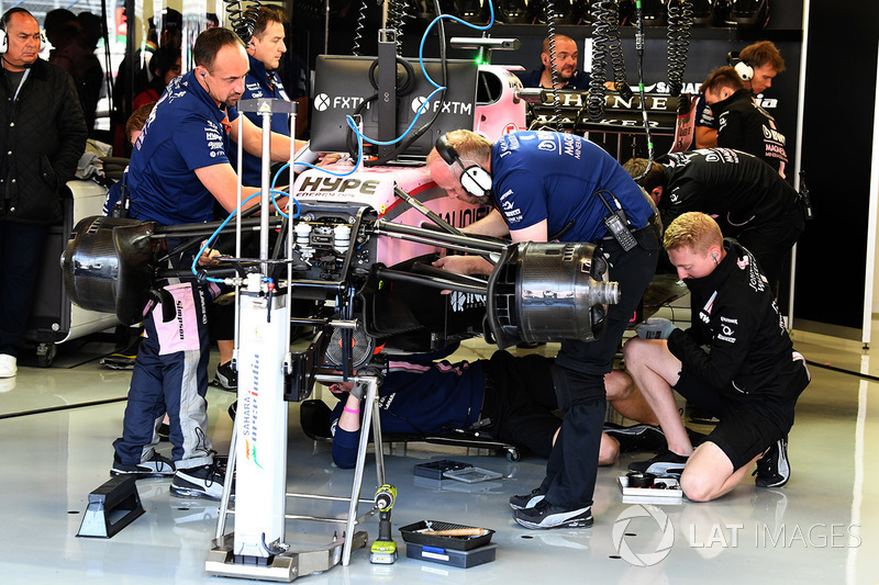 Sahara Force India VJM10 is worked on in the garage