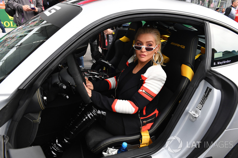 Christina Aguilera, in the Safety car