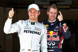 Polesitter Sebastian Vettel, Red Bull Racing, third place Nico Rosberg , Mercedes AMG F1