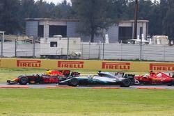 Max Verstappen, Red Bull Racing RB13, leads, Lewis Hamilton, Mercedes AMG F1 W08 and Sebastian Vette